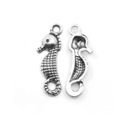 Packet of 20 x Antique Silver Tibetan 23mm Charms Pendants (Seahorse) - (ZX09565) - Charming Beads